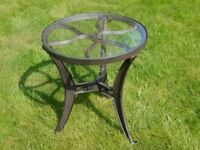 An Industrial Vintage Style Glass Top Cast Metal Side Table