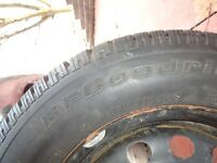 4 BF Goodrich Winter Slalom tires on rims