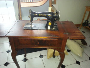 Singer sewing machine in cabinent