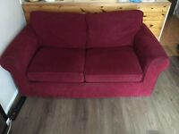 Next two seater sofa bed and matching armchair in red fabric
