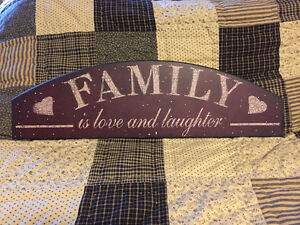 family is love and laughter sign / wall plaque