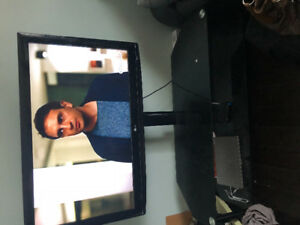 40 inch LG TV with new stand $399.