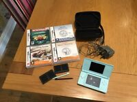 Nintendo DS with 4 games and case.