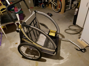 Kids chariot lol connects to mom or dads bike for a free ride