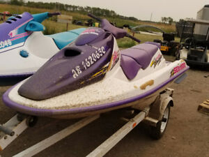 1996 Polaris and 2000 Seadoo with double trailer