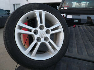 """16"" Mitsubishi Rims & P205/50R16 Goodyear Eagle Tires"""