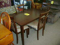 New table and four chairs. $299.