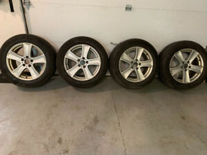 Original 18' BMW X5 Wheels and winter tires. 500$
