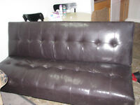 Dark brown leather fold down couch