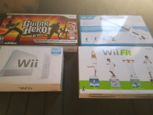 Wii complète + Guitar hero + Wii fit + jeux