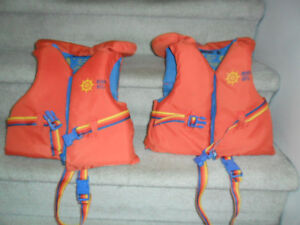 2 Child Life Jackets.$15 for both. 30-60 lbs