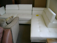 Awesome new white leather sectional. $1499.