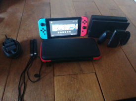 Red and Blue Nintendo Switch with 400 extra GBs and £300 of games
