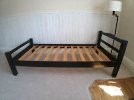 Painted black single bed frame with foam mattress