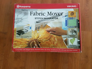 Fabric mover with stitch regulater