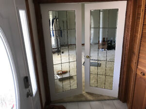 Two 15 lite indoor French doors