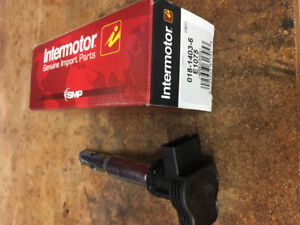 Brand new ignition coil and used spark plugs, Audi/VW 2.0t