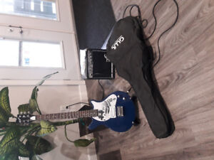 First act electric guitar and amp.
