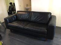 2 x retro black leather sofas