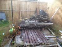 Pile of wood planks need gone ASAP
