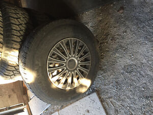 Tires and rims from a Chevy Vandura London Ontario image 2