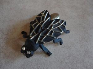 Vintage black metal fly shaped bottle opener
