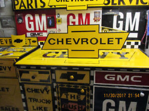 DIFFERENT CHEVROLET AND GM SIGNS.