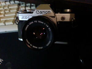 CANON AE_1  film camera with Canon lens FD  50mm 1:1.8