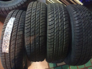 Two sets of NEW R14 all season tires 195 70 14 or 205 70 14
