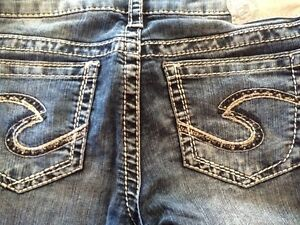 2 pairs of silver jeans