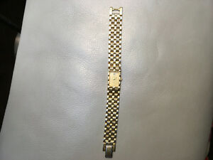 Gold watch with real diamond piece in face