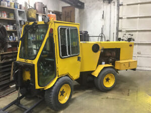Diesel Trakless with plow,Blower and sweeper