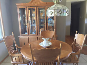 Matching oak table, chairs, leaf and hutch
