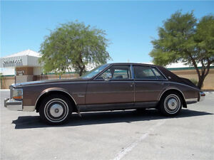 Wanted 1980-1985 Brown cadillac Seville (two tone)
