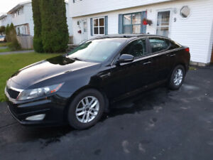 2011 Kia Optima EX GDI with extra rims and new tires asking 4500