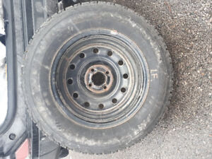 Four 14 Inch Firestone Winter Force 185/70 RI4 Tires and Rims