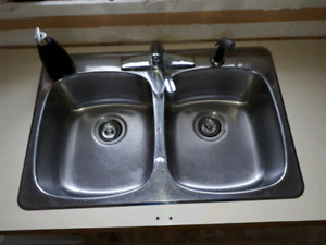 Double kitchen sink with tap.