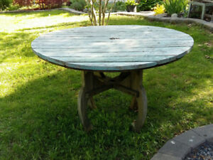 For sale  - large round wooden outside table