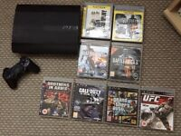 PlayStation 3 slim model with 8 games