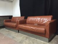 Matching brown leather sofas