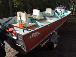 16 ft Lund boat with 20 hp four stroke Mercury motor and trailer