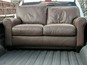Like new leather love seat