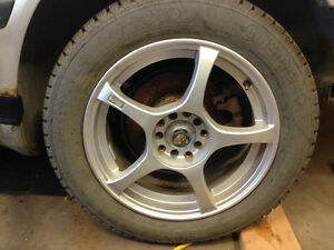 Four studded winter tires and Enkei Rims