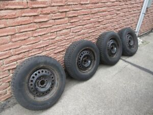 4 Used Winter Snow Tires mounted on Rims