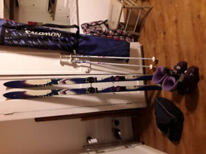 skis, boots, poles, bags