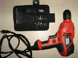 Black and Decker dr250-ca drill and a set of drill bits
