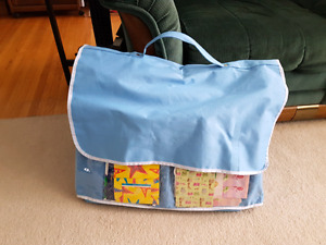 Gift bag storage tote with gift bags