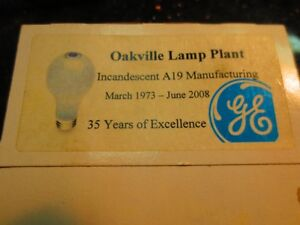 Pair of anniversary GE 60 watt light bulbs marked Oakville