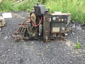 petter diesel generator running n antique gas pump
