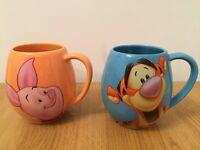 Two large Disney mugs